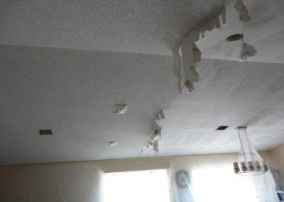 One half of ceiling scraped